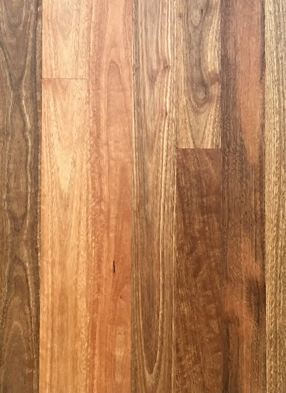 Australian Spotted Gum has brown tones, some creamy strips, and elegant cathedral grain interspersed with rippling fiddleback grain. ©.